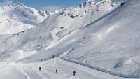 Skiers on the Plan des Veaux piste in Sainte Foy. © Mark Junak